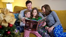 family on in suite reading christmas story at waldorf astoria