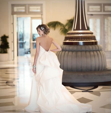 Bride by lobby clock