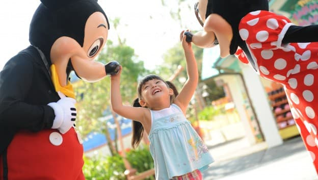 little girl with mickey and minnie in Orlando