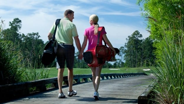 couple with golf bags
