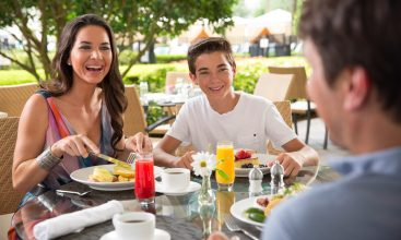 Family dining al fresco at Oscar's Brasserie