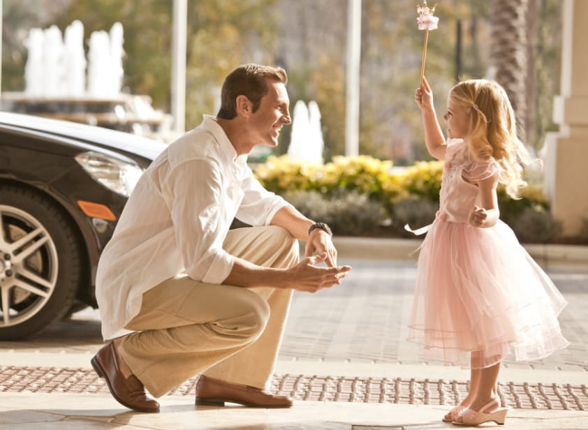 dad and daughter on front drive
