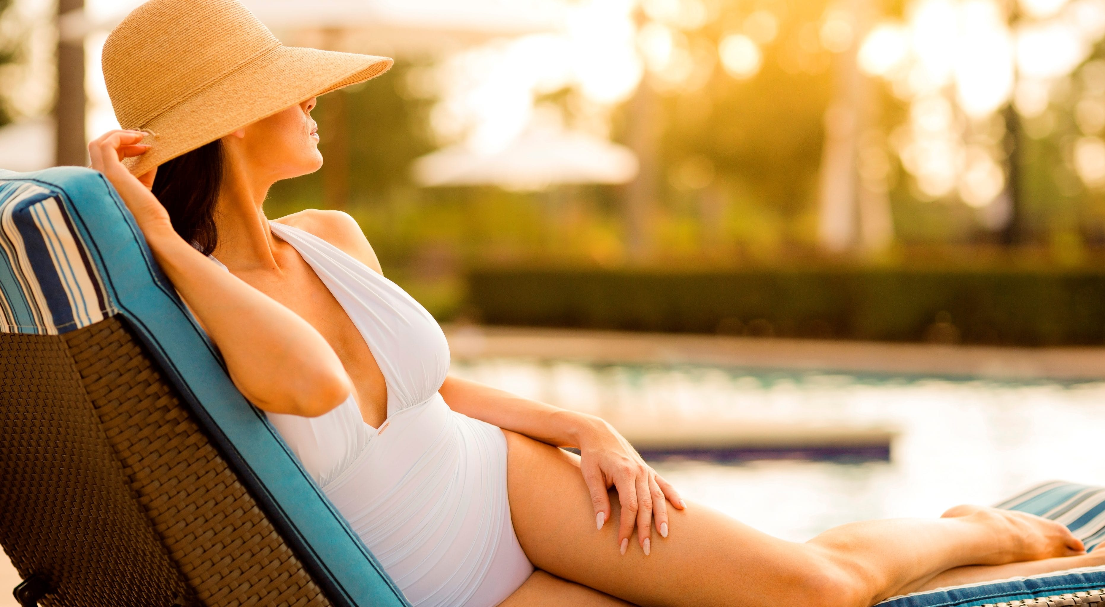 Lady relaxing by cabana pool