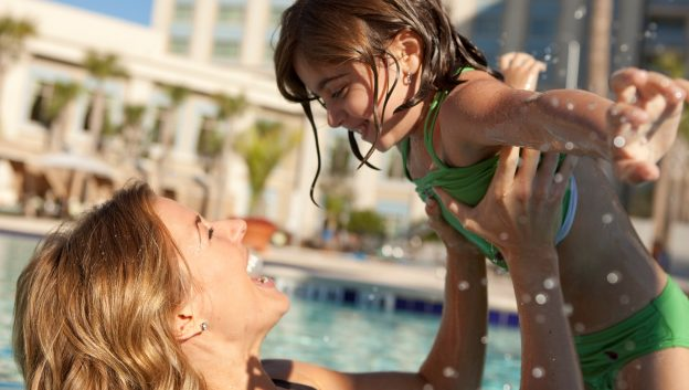mom and daughter laughing in the pool