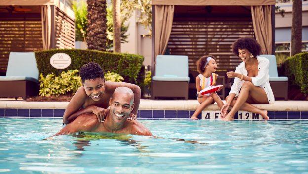 Family enjoying poolside cabana
